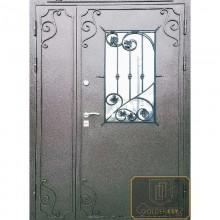 Железная дверь входная с элементами ковки